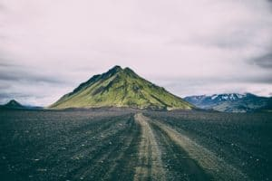 an image of a volcano at the end of a road